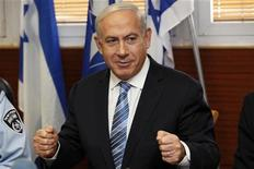 Israel's Prime Minister Benjamin Netanyahu gestures during his visit to the police headquarters in Jerusalem November 22, 2012. REUTERS/Gali Tibbon/Pool