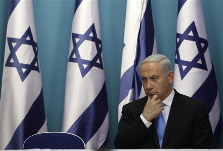 Israel's Prime Minister Benjamin Netanyahu sits after delivering a statement in Jerusalem November 21, 2012. Netanyahu hinted on Wednesday that if an Egyptian-brokered truce with Islamist militants in Gaza did not work Israel would consider ''more severe military action'' against the Palestinian territory. REUTERS/Baz Ratner