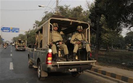 Soldiers from Pakistan's paramilitary Rangers forces patrol on a road ahead of the Ashura ceremony to mark the death of Hussein, the grandson of Prophet Mohammad, in Lahore November 23,2012. REUTERS/Mohsin Raza