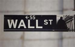 The Wall Street sign is seen near the New York Stock Exchange, November 19, 2012. REUTERS/Chip East (UNITED STATES - Tags: BUSINESS)