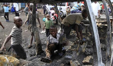 Children play on a burnt truck that belonged to the Congolese army in Ndosho near Goma November 21, 2012. Foreign ministers from nine African countries on Wednesday urged other nations on the continent to contribute troops to an international force to fight rebels in the Democratic Republic of Congo's turbulent east, a Ugandan government spokesman said. The plea - which comes at a time when the M23 rebels appear to have the Congolese army on the backfoot - was signed by Congo, Rwanda, Uganda, Burundi, Tanzania, Kenya, Sudan, Congo Republic and Zambia. REUTERS-James Akena