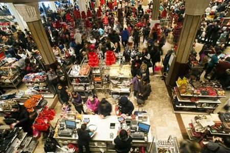 Shoppers look over items on sale at a Macy's store in New York, November 23, 2012. REUTERS/Keith Bedford