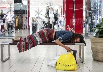 Jasmine Britton, 18, of Huntington Beach rests while shopping at the Los Cerreitos Center mall on Black Friday in Cerritos, California, November 23, 2012. REUTERS/Bret Hartman