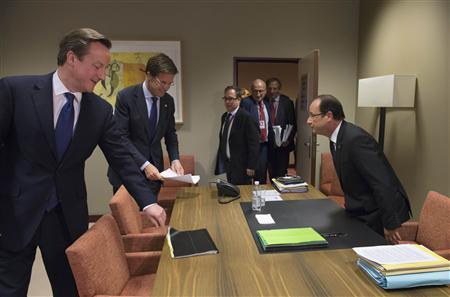 French President Francois Hollande (R) takes his seat before a meeting with British Prime Minister David Cameron (L) and Dutch Prime Minister Mark Rutte (2nd L) at the EU council headquarters in Brussels, November 23, 2012, as part of a two-day European Union leaders summit. REUTERS/Bertrand Langlois/Pool