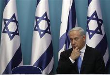 Israel's Prime Minister Benjamin Netanyahu sits after delivering a statement in Jerusalem November 21, 2012. REUTERS/Baz Ratner