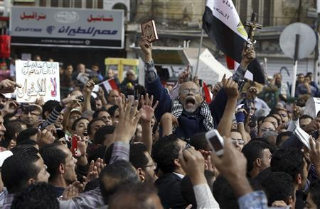 Protesters chant slogans against Egyptian President Mohamed Mursi during a demonstration at Tahrir square in Cairo November 23, 2012. REUTERS/Mohamed Abd El Ghany