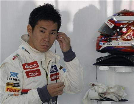 Sauber Formula One driver Kamui Kobayashi of Japan gets ready for the first practice session of the Indian F1 Grand Prix at the Buddh International Circuit in Greater Noida, on the outskirts of New Delhi, October 26, 2012. REUTERS/Vivek Prakash