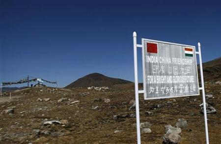 A signboard is seen from the Indian side of the Indo-China border at Bumla, in Arunachal Pradesh, November 11, 2009. REUTERS/Adnan Abidi/Files