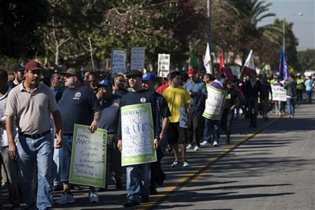 Striking Walmart workers and supporters march in protest at a store on Black Friday in Paramount, California, November 23, 2012. REUTERS/Bret Hartman