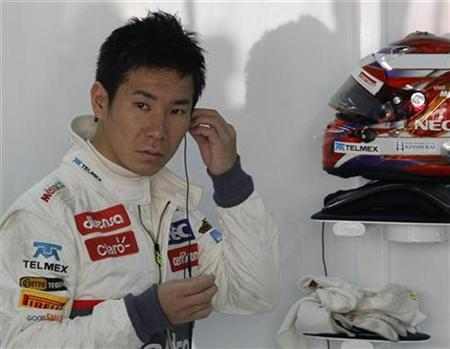 Kamui Kobayashi of Japan gets ready for the first practice session of the Indian F1 Grand Prix at the Buddh International Circuit in Greater Noida, on the outskirts of New Delhi, October 26, 2012. REUTERS/Vivek Prakash/Files