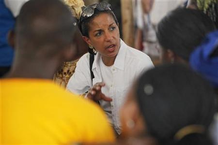 U.S. Ambassador to the United Nations Susan Rice (C) discusses the Libyan refugee situation with Ivorian refugees during the U.N. Security Council members' visit to the PTP camp in Liberia May 22, 2012. REUTERS/Thierry Gouegnon/Files