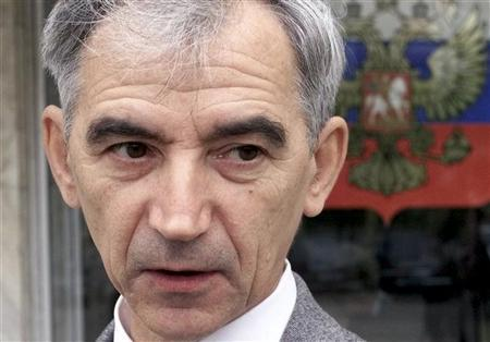 Russian physicist Valentin Danilov stands outside the Krasnoyarsk regional court before his trial resumption in this September 14, 2004 file photo. REUTERS/Ilya Naymushin/Files