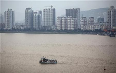 A passenger boat is seen crossing a river in Wenzhou, Zhejiang province October 17, 2011. REUTERS/Carlos Barria/Files