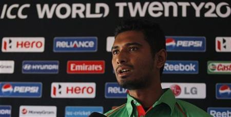 Bangladesh's Mohammad Mahmudullah speaks to reporters during an open session news conference ahead of the World Twenty20 cricket series in Colombo, September 14, 2012. REUTERS/Dinuka Liyanawatte/Files