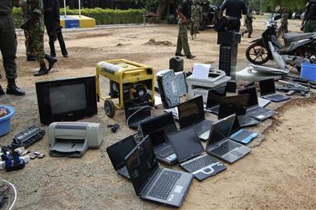Electronic gadgets seized from suspected Islamic sect members of Boko Haram are displayed following a raid conducted on Monday in a military barrack in northern city of Kano September 18, 2012. REUTERS/Stringer/Files