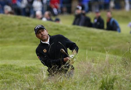Jeev Milkha Singh watches his shot from the rough on the 15th hole during the second round of the British Open golf championship at Royal Lytham & St Annes, northern England July 20, 2012. REUTERS/Eddie Keogh