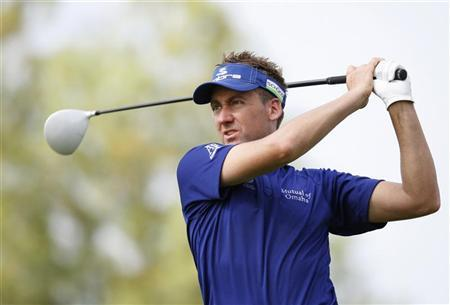 Ian Poulter of England watches his shot from the second tee during the first round of the DP World Tour Championship at Jumeirah Golf Estates in Dubai, November 22, 2012. REUTERS/Nikhil Monteiro