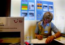 A German TUI employee works at the welcome desk in the Olympia Riviera resort in the town of Kyllini some 285 kms southwest of Athens May 31, 2012. REUTERS/Yannis Behrakis
