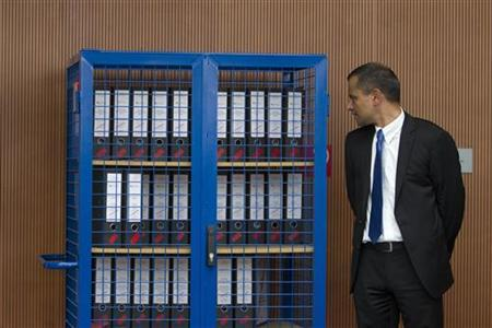 The chairman of a parliamentary enquiry into the security services' handling of the NSU Neo-Nazi terror cell Sebastian Edathy stands next to a locker with investigation documents as he waits for the arrival of domestic intelligence service head Heinz Fromm (not pictured) in Berlin, July 5, 2012. REUTERS/Thomas Peter