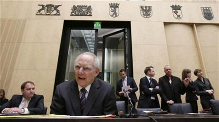 Germany's Finance Minister Wolfgang Schaeuble (2nd L) arrives for a speech at the German upper house of Parliament Bundesrat in Berlin November 23, 2012. REUTERS/Tobias Schwarz