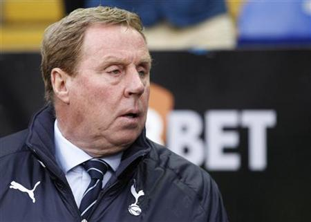 Tottenham Hotspur's then manager Harry Redknapp watches ahead of their English Premier League soccer match against Bolton Wanderers at the Reebok Stadium in Bolton, northern England, May 2, 2012. REUTERS/Darren Staples/Files
