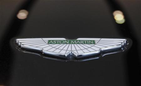The logo of Aston Martin is seen on a car inside the company's showroom in Mumbai January 2, 2012. REUTERS/Danish Siddiqui
