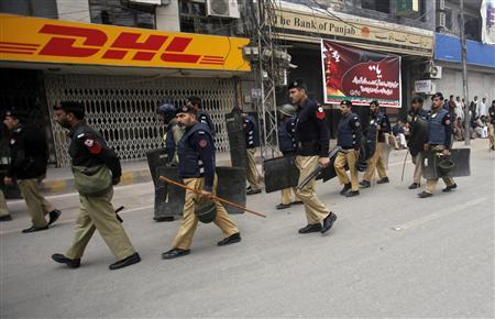 Police arrive to secure an area during a Muharram procession ahead of Ashura, which marks the death of Hussein, the grandson of Prophet Mohammad, in Peshawar November 24, 2012. A roadside bomb killed at least seven people near a Shi'ite procession in Dera Ismail Khan in Pakistan's northwest on Saturday, police said, with security forces on high alert over fears of large-scale sectarian attacks on the minority sect across the country. REUTERS/Fayaz Aziz