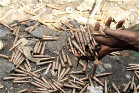 A Congolese Revolutionary Army (CRA) fighter collects bullets from the floor at a military barracks November 23, 2012, abandoned by fleeing government soldiers early this week as they capture Goma in the Democratic Republic of Congo. REUTERS/James Akena