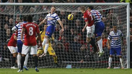 Manchester United's Darren Fletcher (3rd R) heads the ball to score his sides second goal during their English Premier League soccer match against Queens Park Rangers at Old Trafford in Manchester, northern England November 24, 2012. REUTERS/Phil Noble