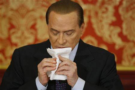 Italy's former Prime Minister Silvio Berlusconi wipes his face during a news conference at Villa Gernetto in Gerno near Milan October 27, 2012. REUTERS/Alessandro Garofalo