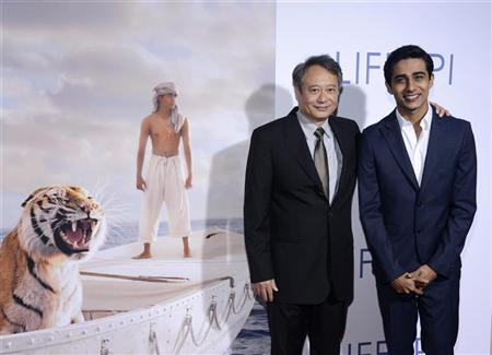 Director Ang Lee (L) and actor Suraj Sharma (R) attend a special screening of the film ''The Life of Pi'' in Los Angeles November 16, 2012. REUTERS/Phil McCarten
