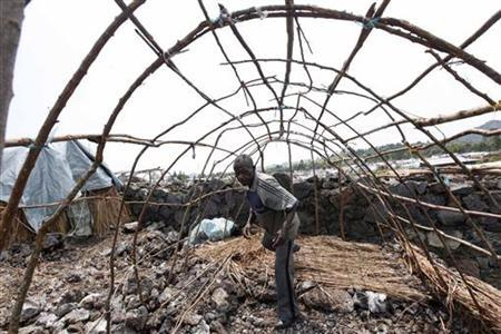 A man displaced by recent fighting in eastern Congo walks through an incomplete makeshift shelter in Mugunga IDP camp outside of Goma, November 24, 2012. REUTERS/James Akena