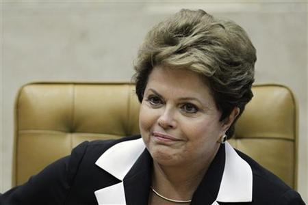 Brazil's President Dilma Rousseff participates in the ceremony of investiture for the new President and Vice-President of the Supreme Court, ministers Joaquim Barbosa and Ricardo Lewandowski, in Brasilia November 22, 2012. REUTERS/Ueslei Marcelino