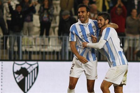 Malaga's Isco (R) celebrates with his team mate Jesus Gamez after scoring a goal against Valencia during their Spanish First Division soccer match at La Rosaleda stadium in Malaga, southern Spain November 24, 2012. REUTERS/Jon Nazca