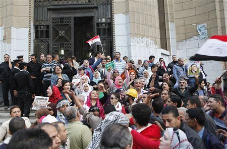 Anti-Mursi protesters chant slogans in front of the Supreme Judicial Council building in Cairo November 24, 2012. Egyptian President Mohamed Mursi faced a rebellion on Saturday from judges who accused him of expanding his powers at their expense, deepening a crisis that triggered calls for more protests following a day of violence across Egypt. Egypt's highest judicial authority, the Supreme Judicial Council, said the decree issued by Mursi on Thursday was an ''unprecedented attack'' on the independence of the judiciary. REUTERS/Asmaa Waguih