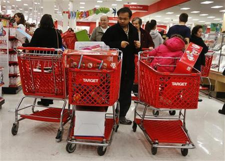 People shop at a Target store in Westbury, New York November 23, 2012. Black Friday, the day following the Thanksgiving Day holiday, has traditionally been the busiest shopping day in the United States. REUTERS/Shannon Stapleton