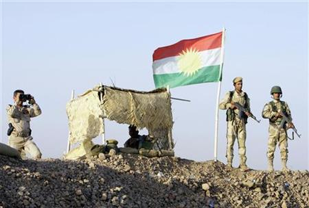 Kurdish Peshmerga soldiers look on at a guard post during a deployment in the area near the northern Iraqi border with Syria, which lies in an area disputed by Baghdad and the Kurdish region of Ninawa province, August 6, 2012. REUTERS/Azad Lashkari/Files