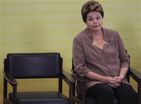 Brazil's President Dilma Rousseff watches a ceremony during the Day of Black Awareness at the Planalto Palace in Brasilia, November 21, 2012. REUTERS/Ueslei Marcelino