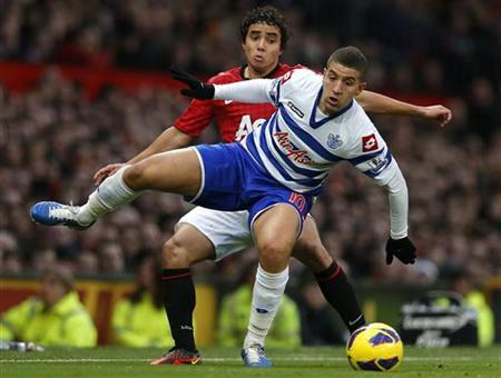Manchester United's Rafael da Silva (back) challenges Queens Park Rangers' Adel Taarbat during their English Premier League soccer match against Manchester United at Old Trafford in Manchester, northern England November 24, 2012. REUTERS/Phil Noble