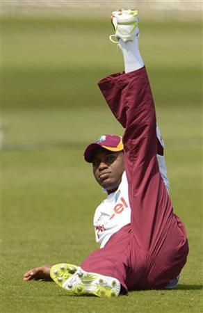 West Indies' Tino Best stretches during a training session at Trent Bridge cricket ground in Nottingham May 24, 2012. REUTERS/Philip Brown/Files