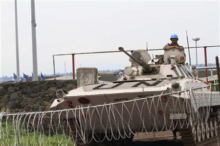 A United Nations (U.N.) armored vehicle guards a barrier at the entrance of the closed airport in Goma November 22, 2012. REUTERS/James Akena/Files