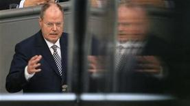 Peer Steinbrueck of the opposition Social Democratic Party (SPD) is reflected in a glass barrier during his speech at a session of the German lower house of parliament Bundestag in Berlin, October 18, 2012. REUTERS/Tobias Schwarz (GERMANY - Tags: POLITICS)