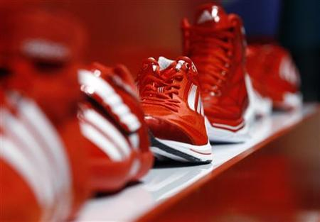 Adidas sport shoes ''Adizero'' are on display at the Adidas innovation laboratory in Herzogenaurach May 7, 2012. U.S. market leader Nike and German rival Adidas are locked in their own Olympic battle to boost athletes' performance and squeeze maximum value out of the London Olympic Games. The Games provide a showcase for new fashions and advances in technology which sportswear suppliers hope will drive sales at a time of economic turmoil in many of their markets, according to news reports on June 20, 2012. Picture taken on May 7, 2012. To match story OLY-BRANDS-BATTLE/ REUTERS/Michael Dalder (GERMANY - Tags: BUSINESS SCIENCE TECHNOLOGY SPORT OLYMPICS)