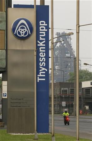 The logo of German industrial conglomerate ThyssenKrupp AG is seen outside the company's headquarter and a steelworks in the western German city of Duisburg May 31, 2012. Duisburg and other nearby cities once were the core of Germany's coal mining and steel producing Ruhr region, but are struggling heavily in debt due to falling steel prices and Germany's highest unemployment rate in the west of the country. REUTERS/Wolfgang Rattay (GERMANY - Tags: BUSINESS COMMODITIES LOGO)
