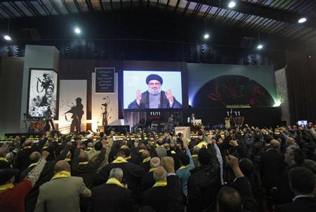 Lebanon's Hezbollah leader Sayyed Hassan Nasrallah addresses supporters from a screen during a rally marking the party's Martyrs Day in Beirut's suburbs, November 12, 2012.REUTERS/Sharif Karim