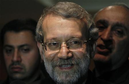 Iran's Parliament speaker Ali Larijani smiles after speaking to journalists at Beirut international airport November 23, 2012. REUTERS/Mohamed Azakir
