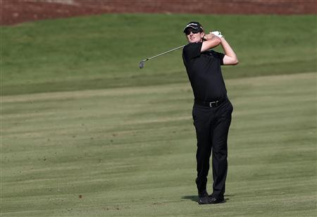 Justin Rose of England watches his shot from the 10th fairway during the fourth and final round of the DP World Tour Championship at Jumeirah Golf Estates in Dubai November 25, 2012. REUTERS/Jumana El Heloueh