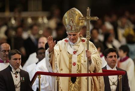 Pope Benedict XVI gestures as he leaves at the end of a consistory mass in St Peter's Basilica at the Vatican November 25, 2012. REUTERS/Tony Gentile