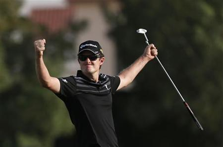 Justin Rose of England reacts at the 18th green during the fourth and final round of the DP World Tour Championship at Jumeirah Golf Estates in Dubai November 25, 2012. REUTERS/Jumana El Heloueh