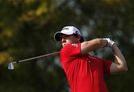Rory McIlroy of Northern Ireland watches his shot from the 11th tee during the fourth and final round of the DP World Tour Championship at Jumeirah Golf Estates in Dubai November 25, 2012. REUTERS/Jumana El Heloueh